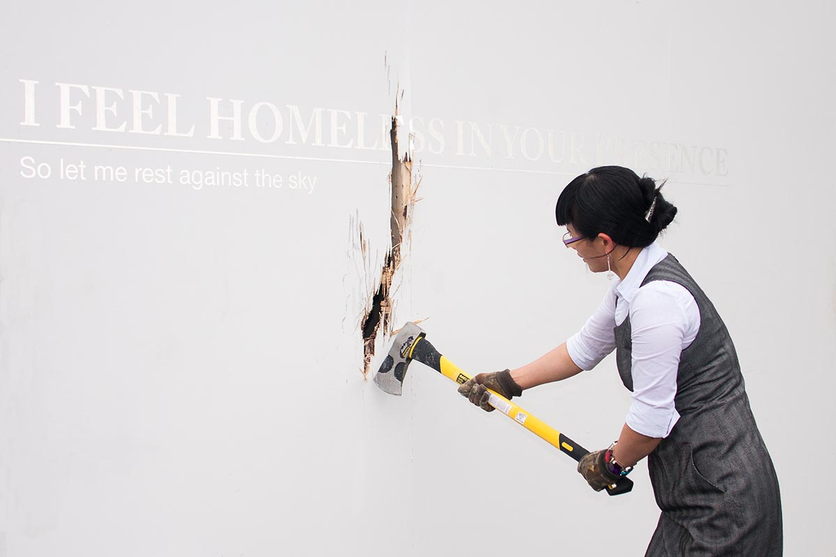 Chun Hua Catherine Dong is destroying a gallery wall for a performance
