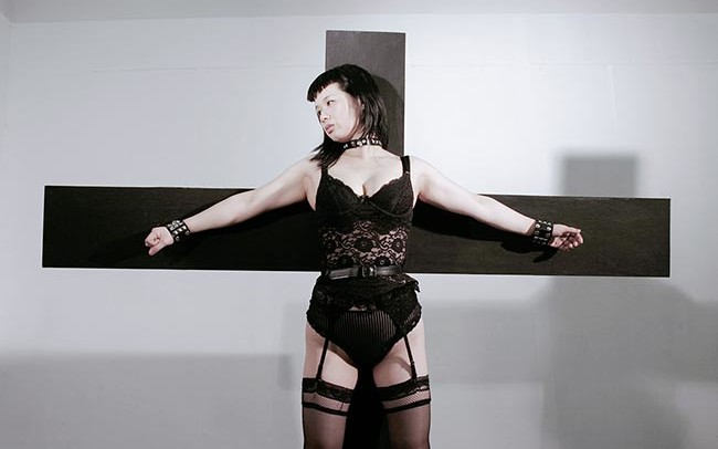 Chun Hua Catherine Dong attaches her body on a cross