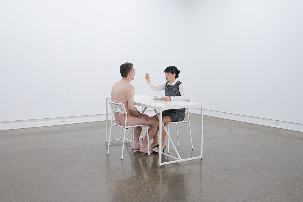 Chun Hua Catherine Dong is feeding pre-masticated rice to a naked man at katzman contemporary in Toronto