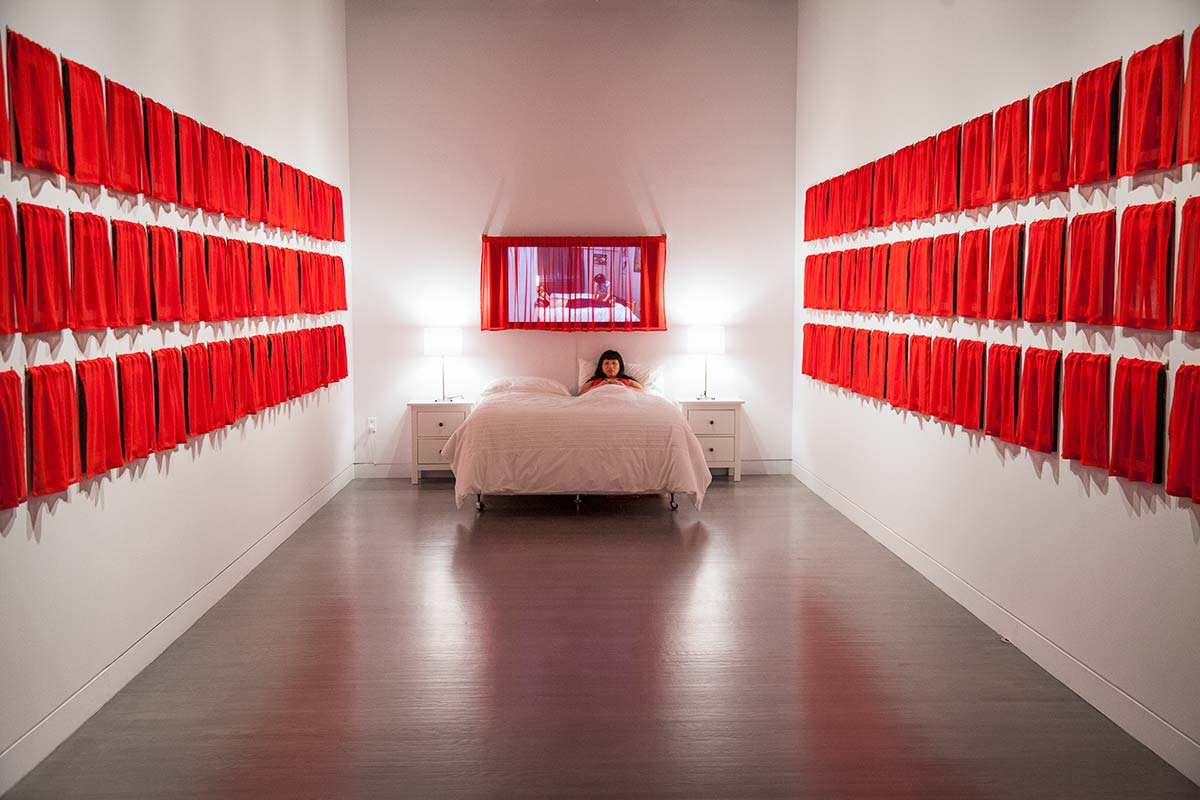 Chun Hua Catherine Dong's work, Husbands and I installation, at Leonard & Bina Ellen Art Gallery in 2012. Chun Hua Catherine Dong also stayed on her bed in the gallery for 60 hours to invite audiences to come to her bed to sleep with her or chat