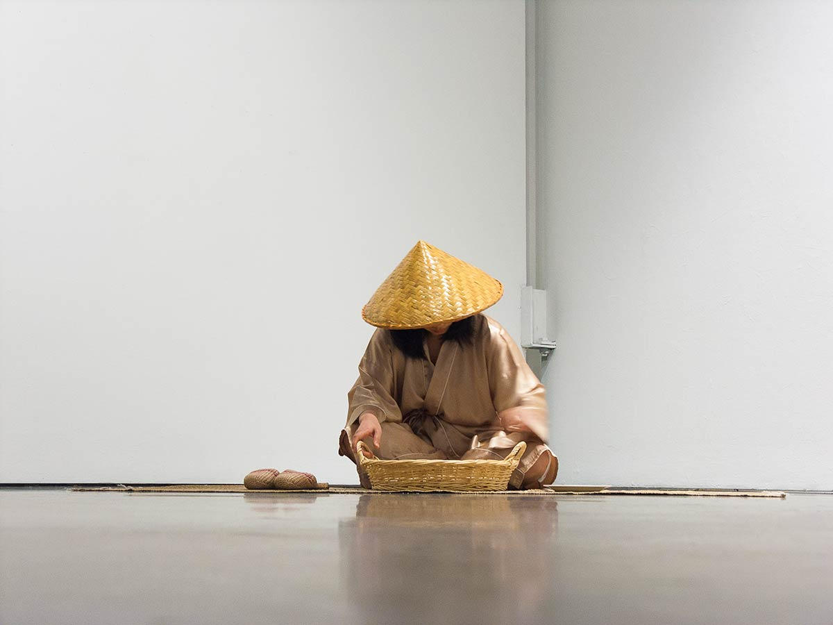 Chun Hua Catherine Dong meditates her rice for hours, reflecting her own ideology about race
