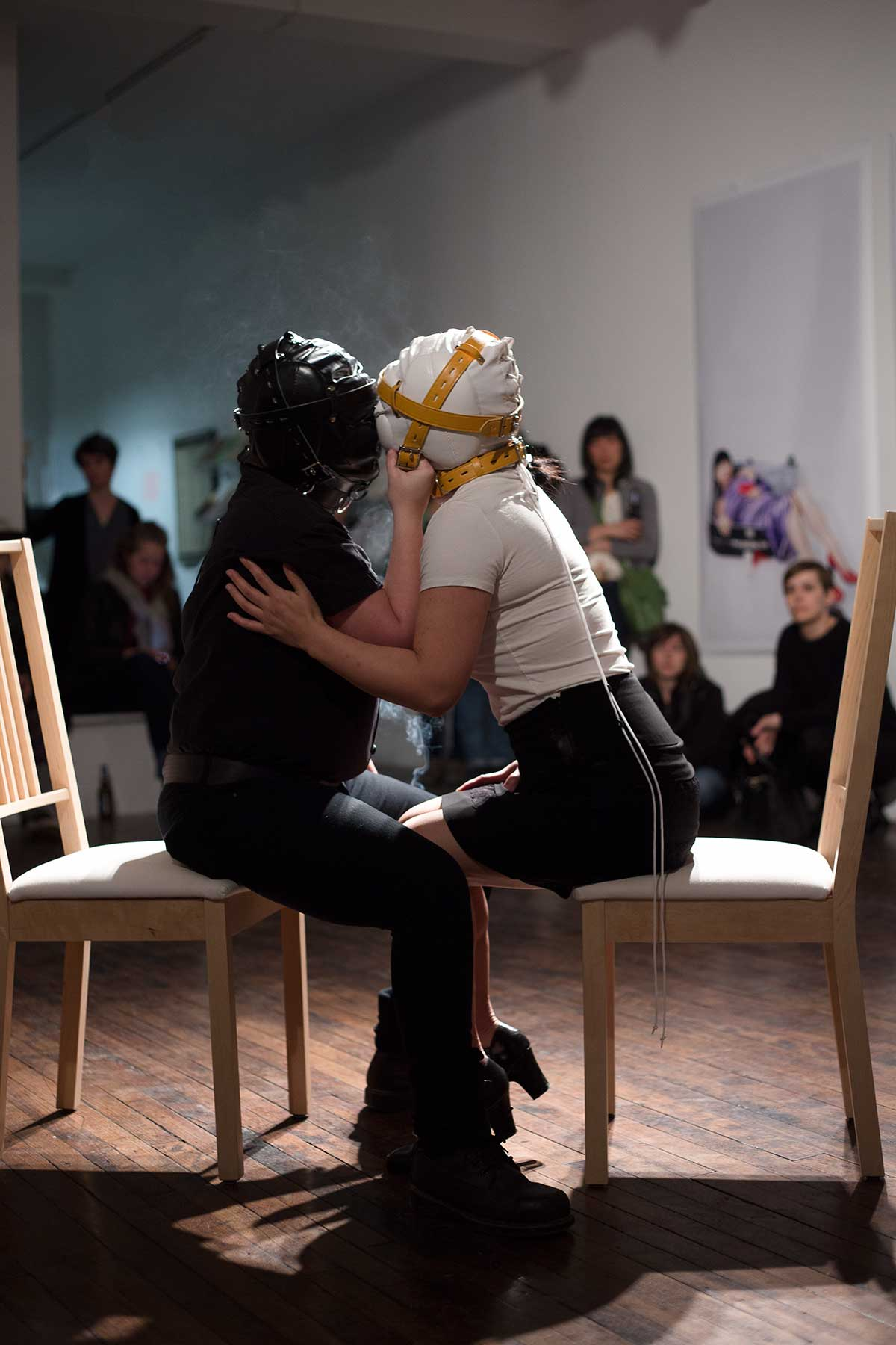 Chun Hua Catherine Dong performs at Articule Montreal: two girls kiss each other while wearing masks