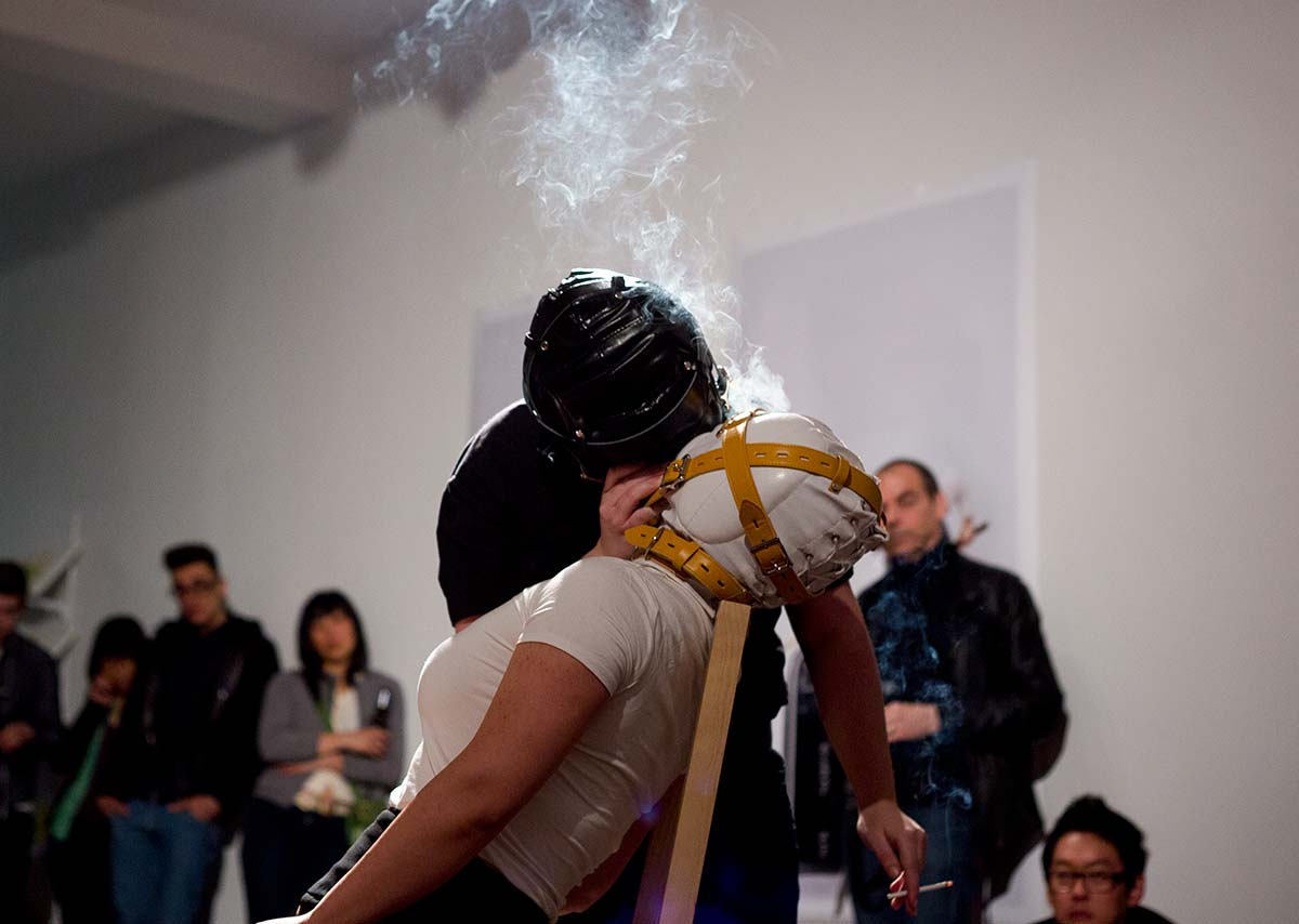 Chun Hua Catherine Dong performs at Articule Montreal: Chun Hua Catherine Dong is kissed by a girl who wears black mask, smoke comes out from their kiss