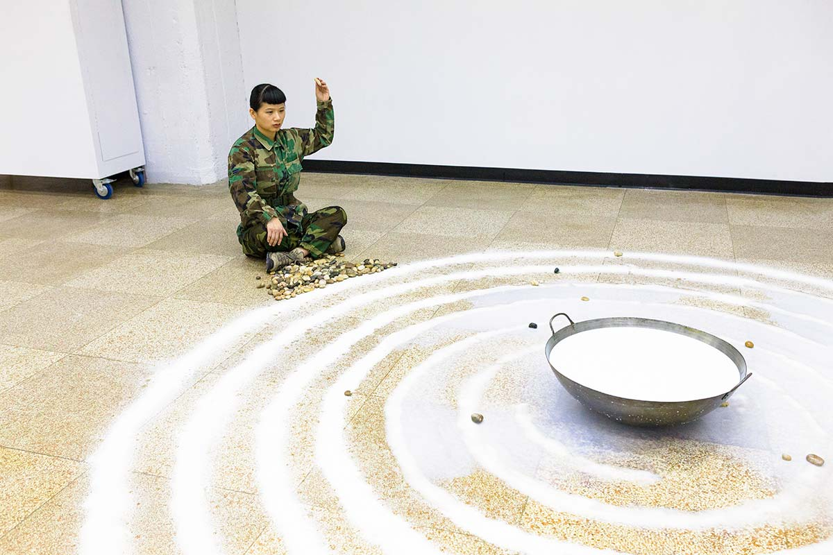 Chun Hua Catherine Dong throws rocks into milk as a way of meditation