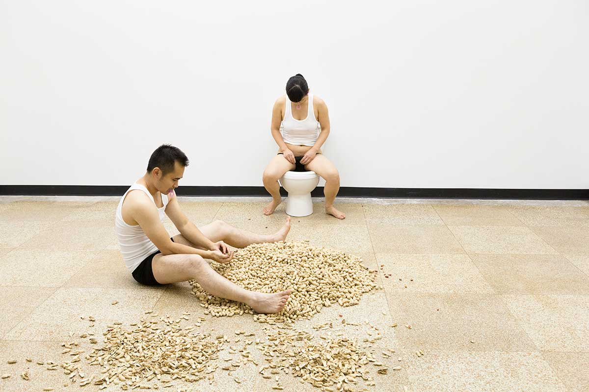 Chun Hua Catherine Dong is dumping peanut seeds into a toilet