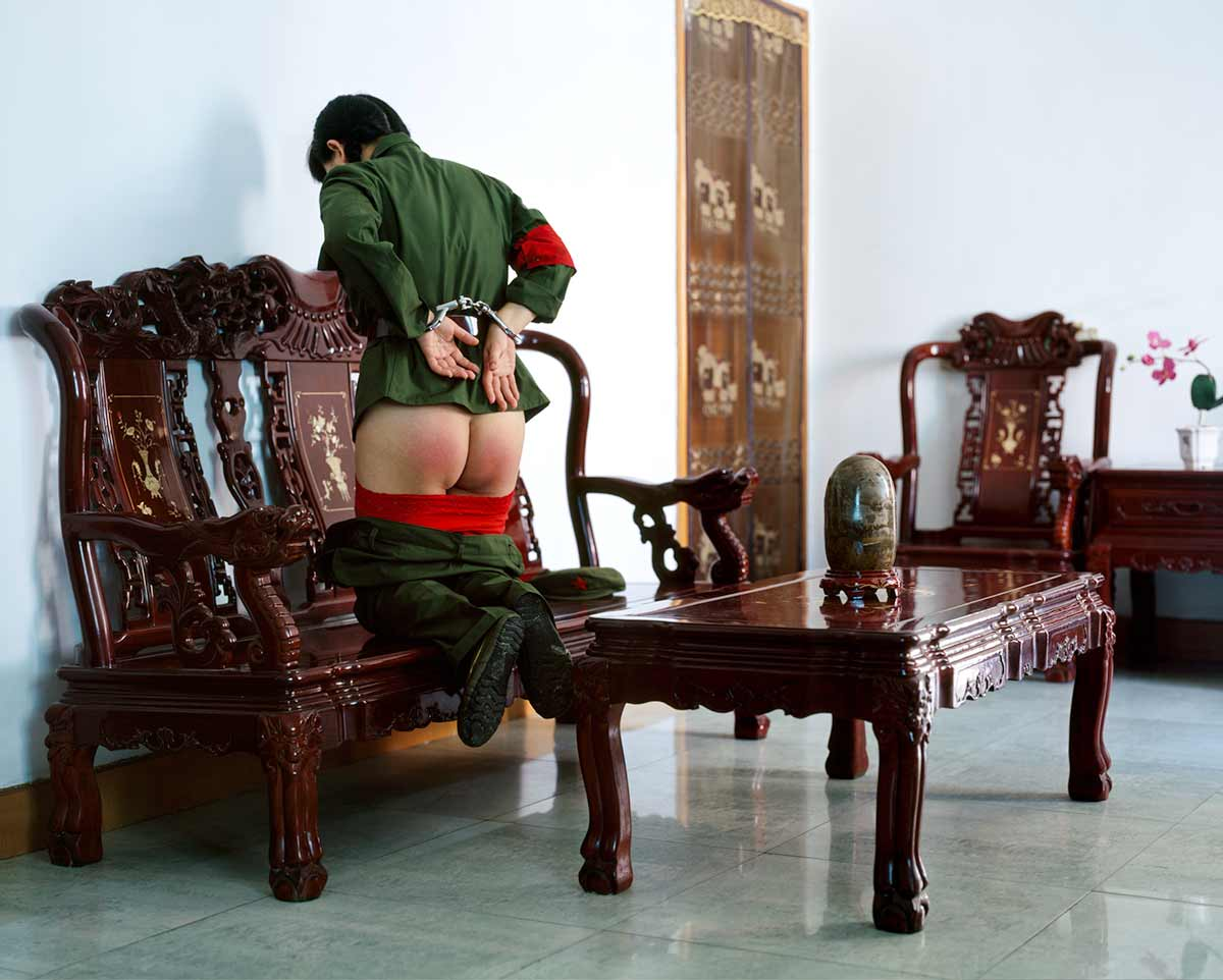 Chun Hua Catherine Dong performs the Red Guard in the Chinese Cultural Revolution. She is spanked and punished