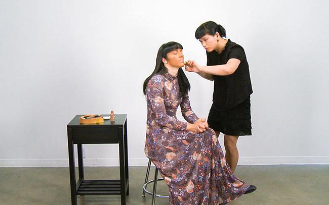 Chun Hua Catherine Dong puts makeup on a participant's face
