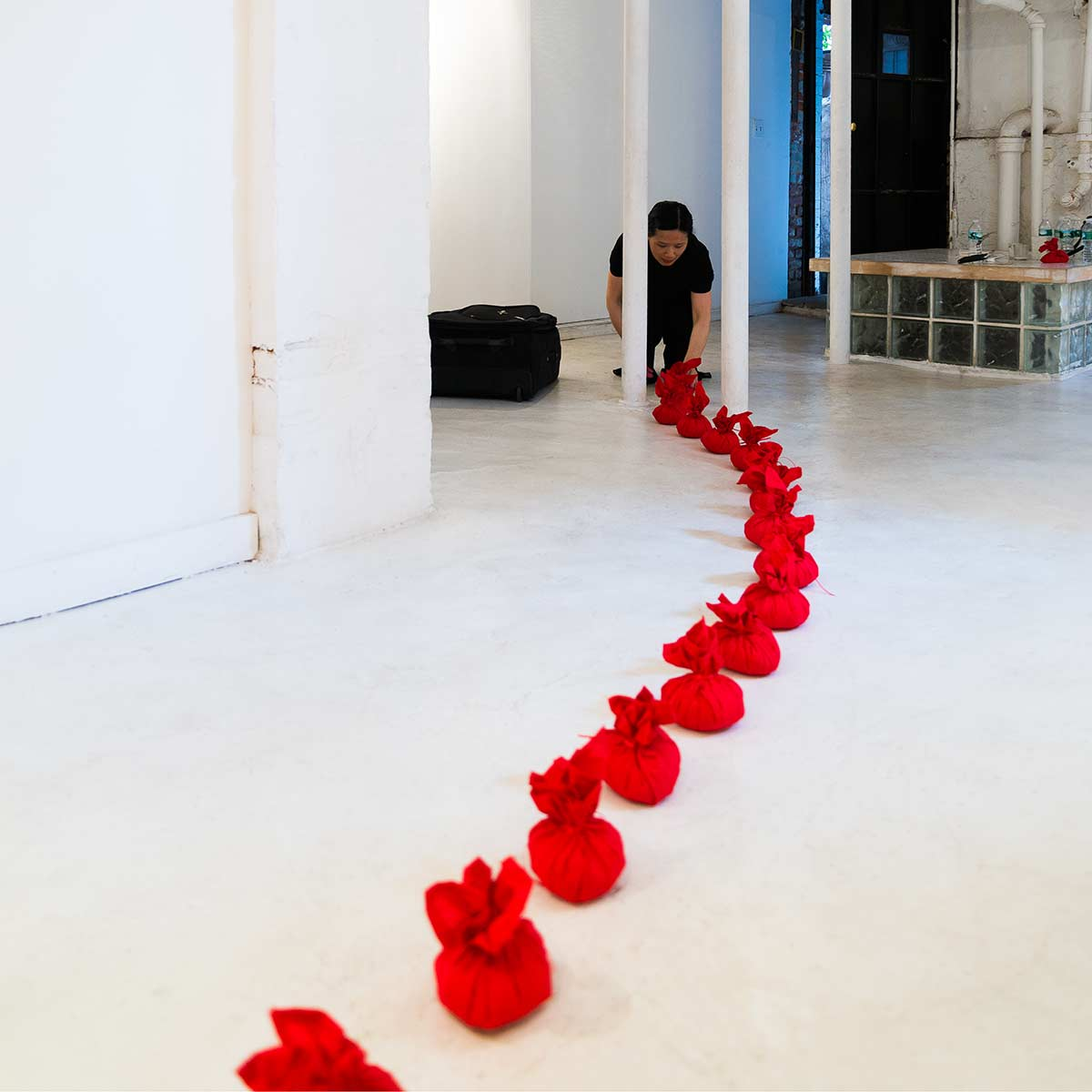 Chun Hua Catherine Dong's performance in New York: she wrapped rice with red handkerchiefs and form them to rice balls, she pressed a rice ball on her forehead and call her name to come home three times with her Chinese dialect