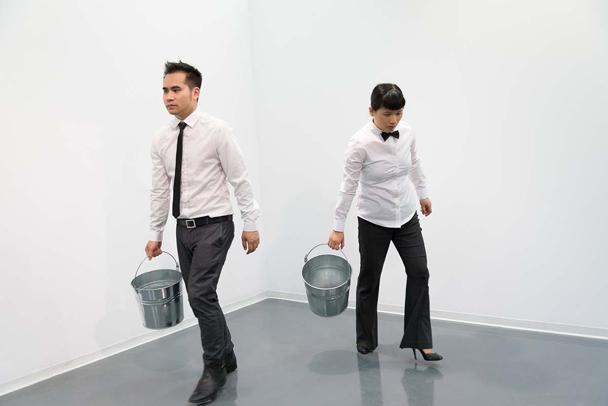Chun Hua Catherine Dong's performance at Qouleur Festival in Montreal: she and her performance partner carried their own buckets and left