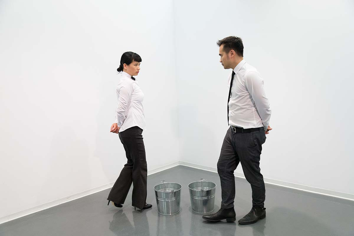 Chun Hua Catherine Dong's performance at Qouleur Festival in Montreal: she and her performance partner were walking around two buckets while looking at each other