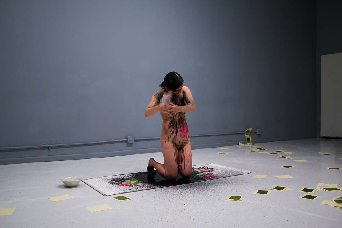 Chun Hua Catherine Dong's performance in Chicago: she shoots herself with ink