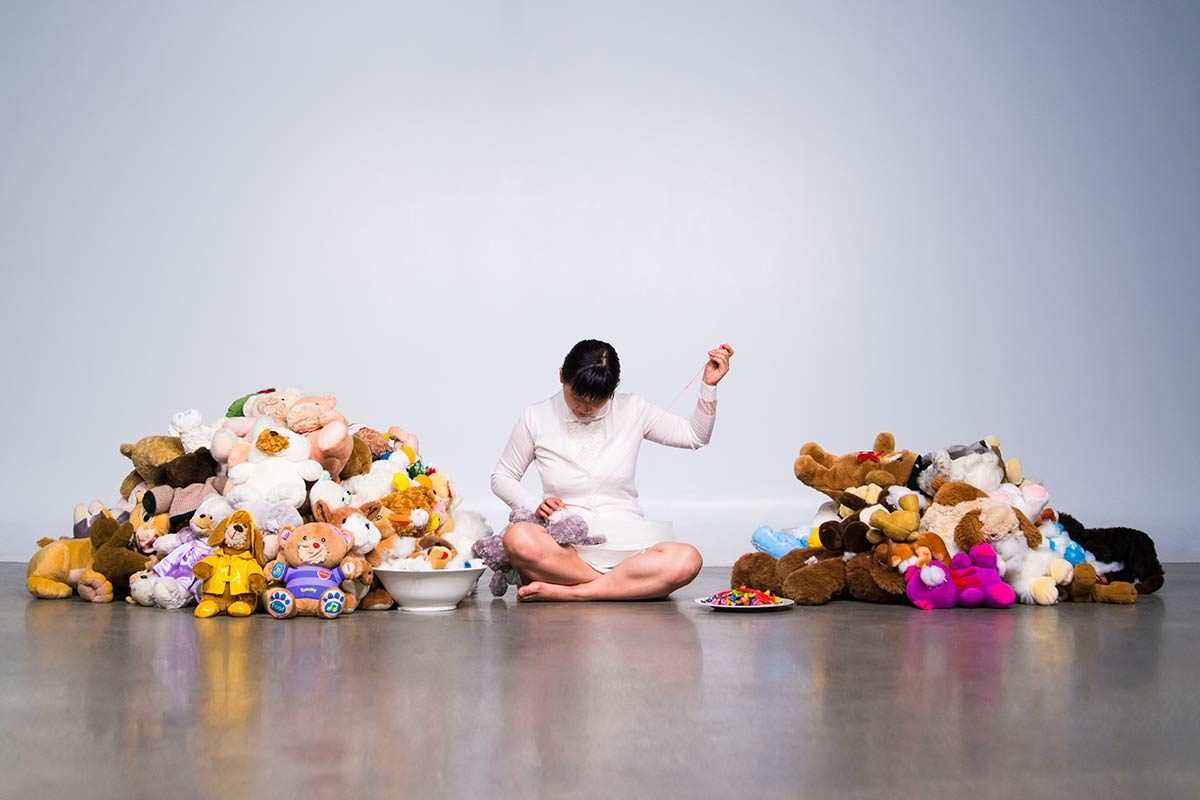 Chun Hua Catherine Dong collected stuffed animals,cut their mouths and sewed different mouths into different stuffed animals