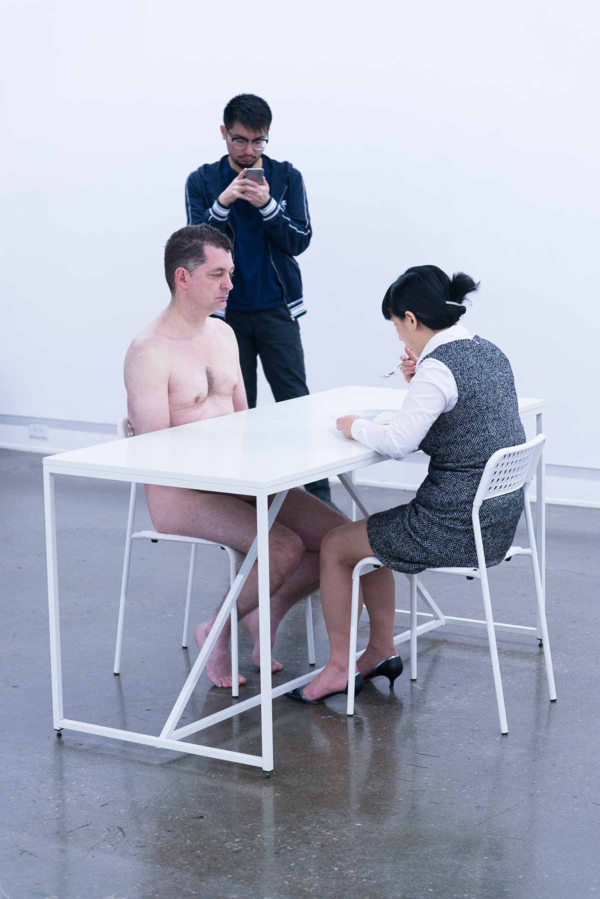 Chun Hua Catherine Dong is feeding pre-masticated rice to a naked man for three hours in Toronto