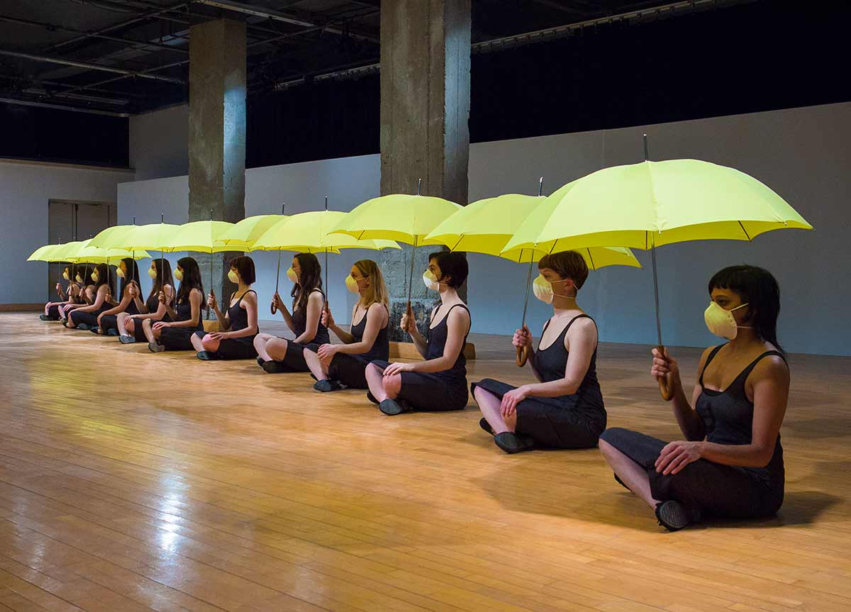 Chun Hua Catherine Dong's Yellow Umbrella performance in Montreal: 12 females hold yellow umbrellas to meditate their political situation