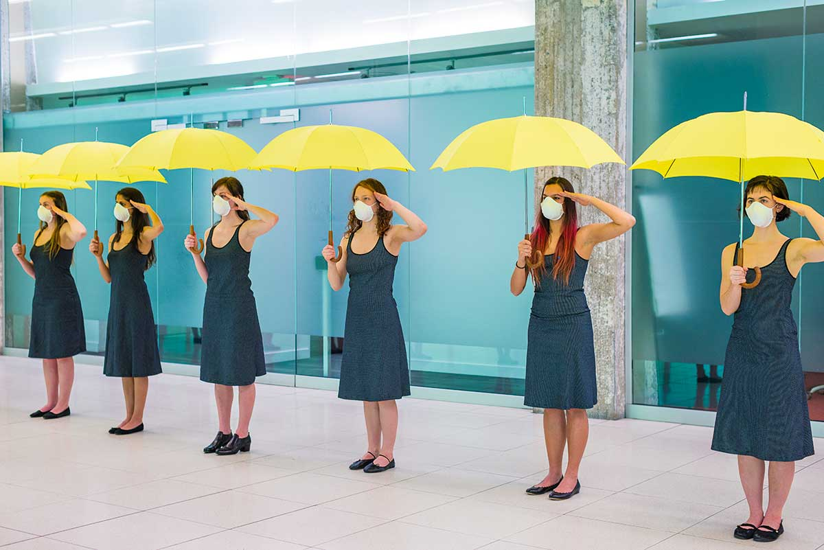 Chun Hua Catherine Dong's Yellow Umbrella performance: 12 dancers salute with their wrong hands