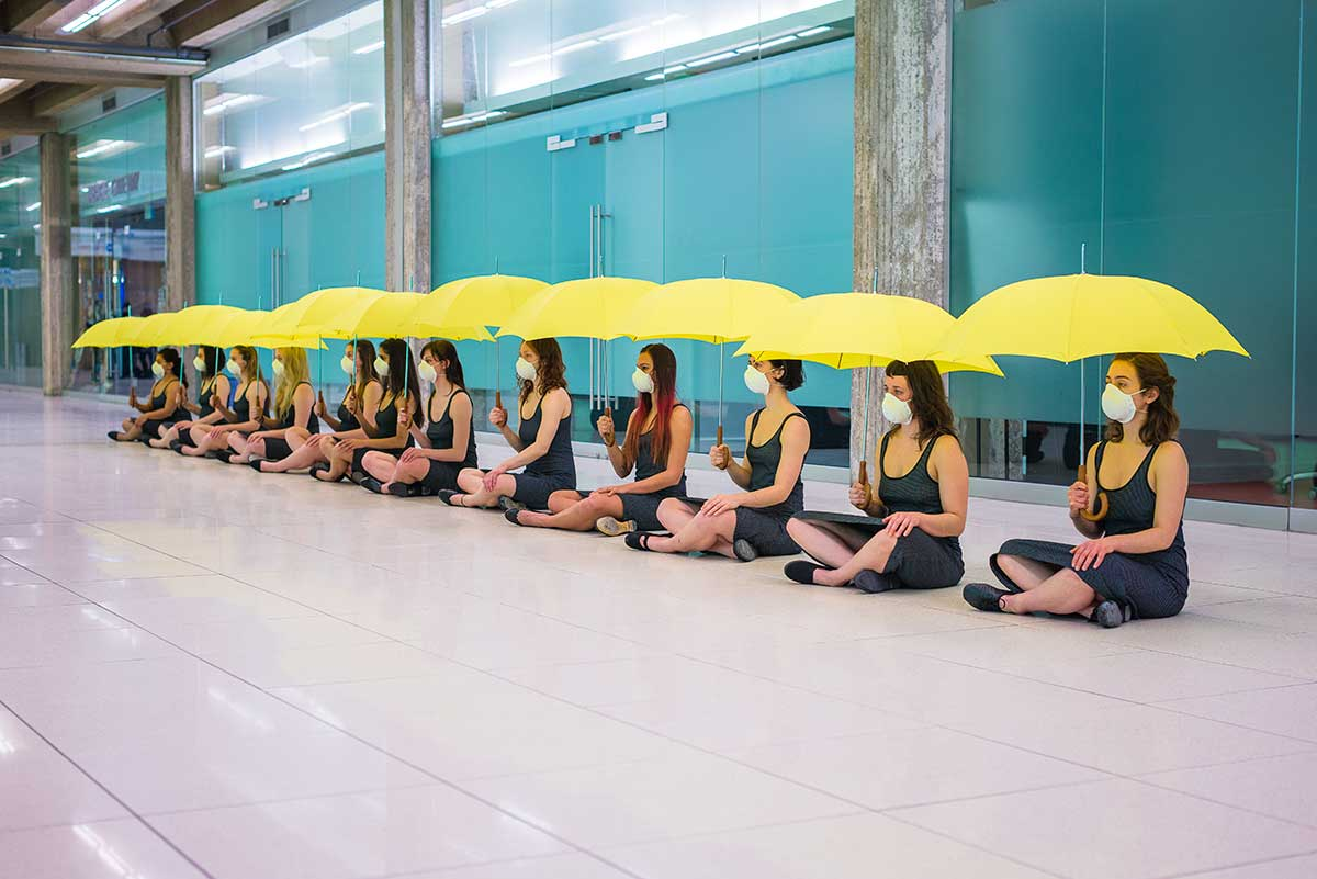 Chun Hua Catherine Dong's Yellow Umbrella performance: 12 females sit on floor to meditate their political situation while holding umbrellas