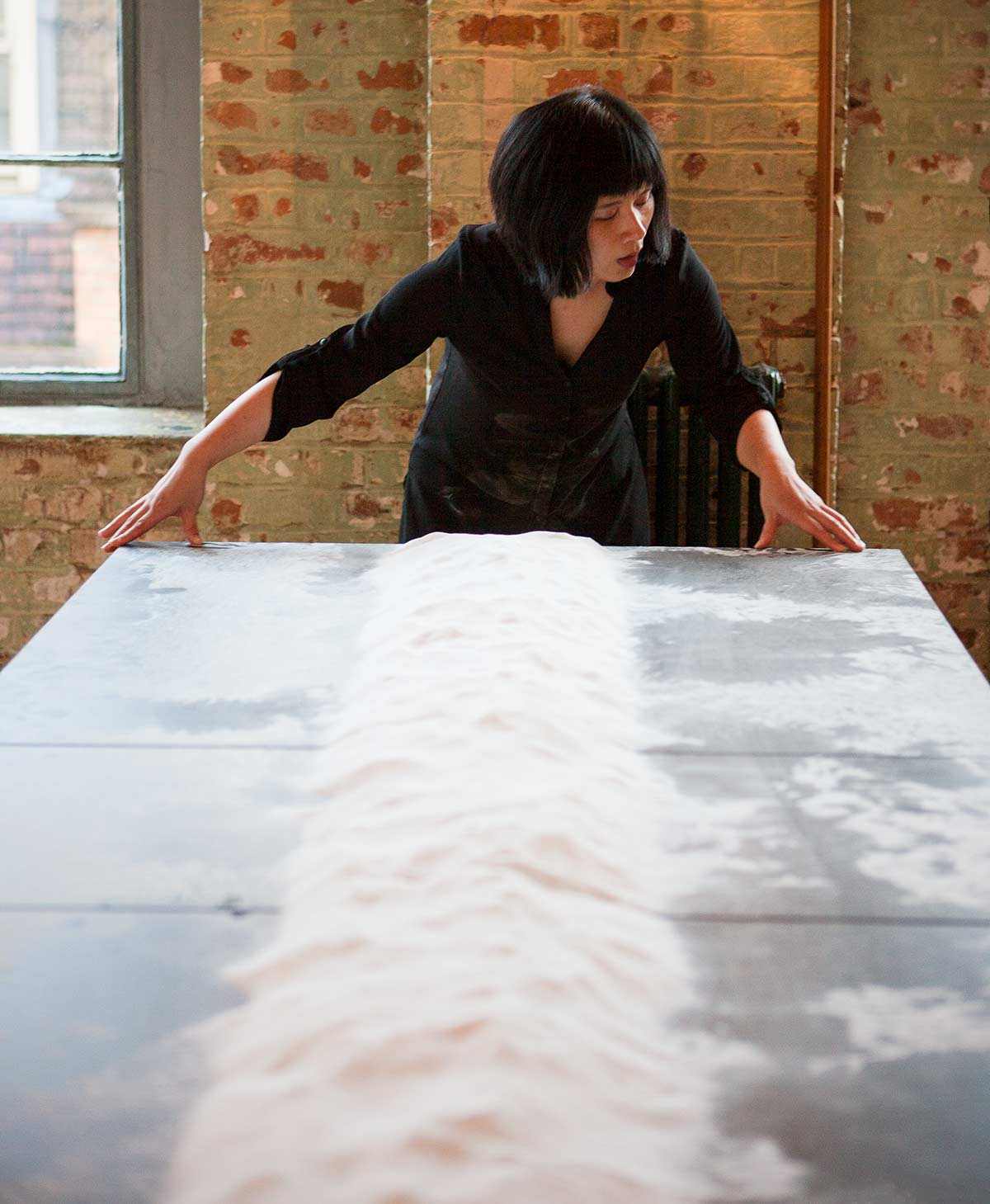Chun Hua Catherine Dong' performance in London, she engages with salt using her body