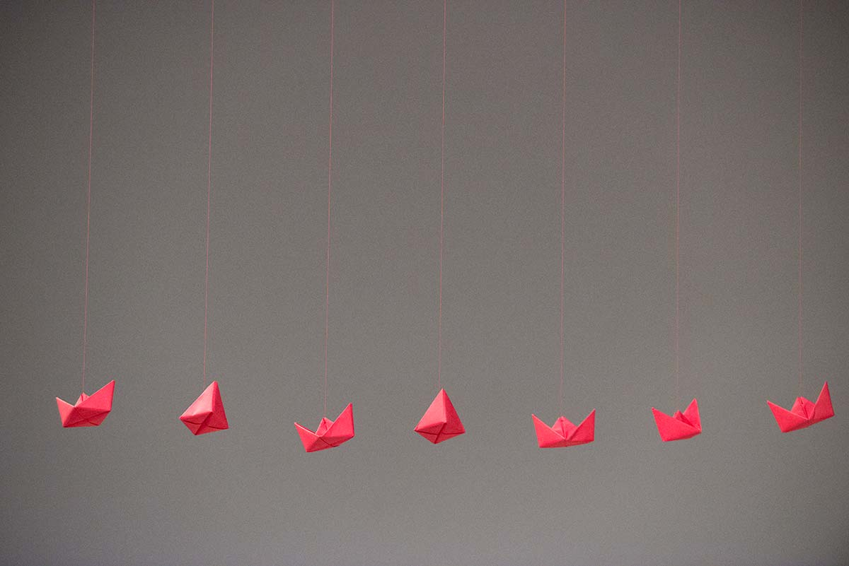 Chun Hua Catherine Dong's performance at 7a11d International Festival of Performance Art in 2016: red paper boats are hung on the celling