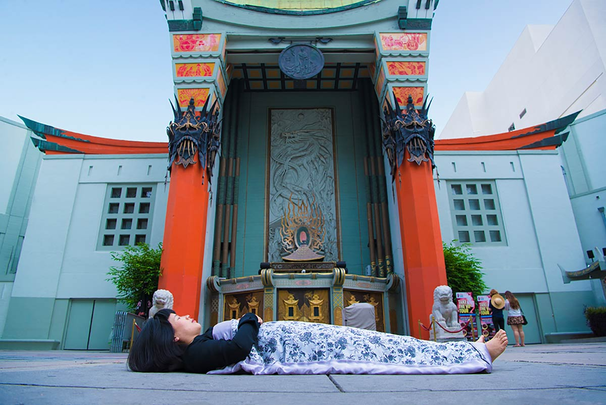 Chun Hua Catherine Dong  is lying in front of TCL Chinese Theatre in Hollywood