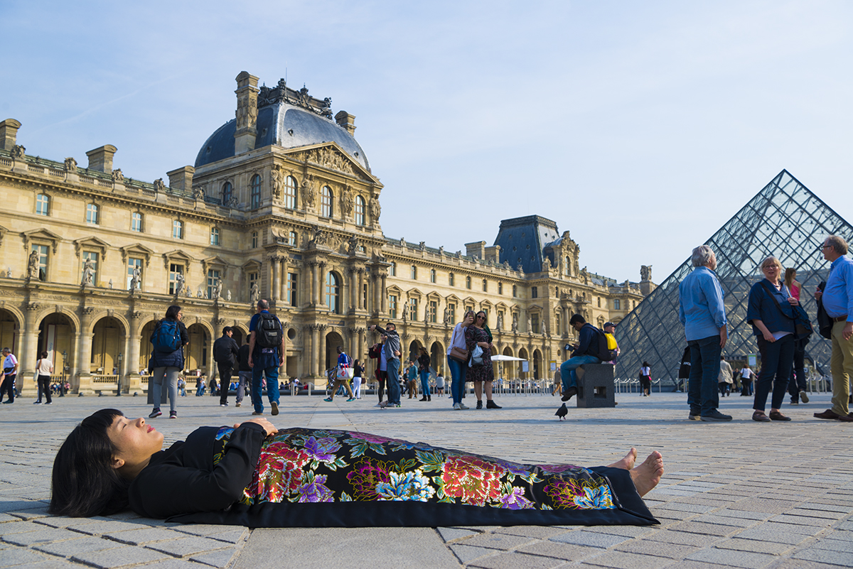 Chun Hua Catherine Dong buries herself at historical sites and tourist attraction in Paris