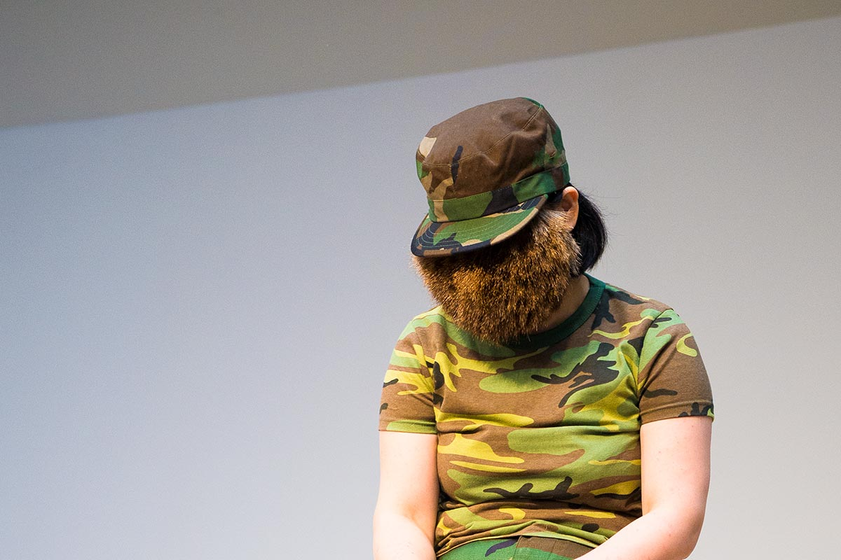 Chun Hua Catherine Dong wears a hairy strange mask from wild animal and military suit